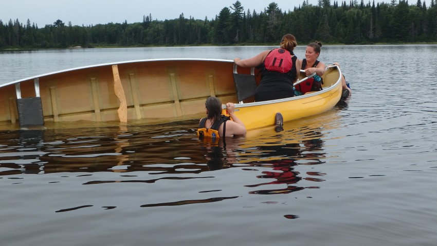 practicing canoe over canoe rescue